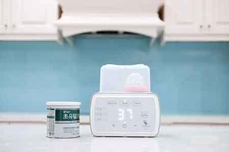 . Máy hâm sữa tiệt trùng hai bình và hâm nóng thức ăn Moaz Bebe MB - 003